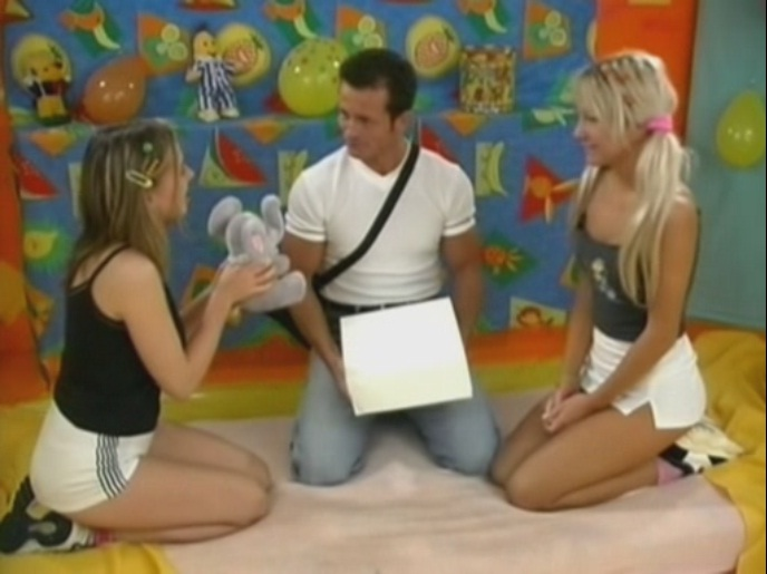 Two stunning teenage babes playing with their mate's cock