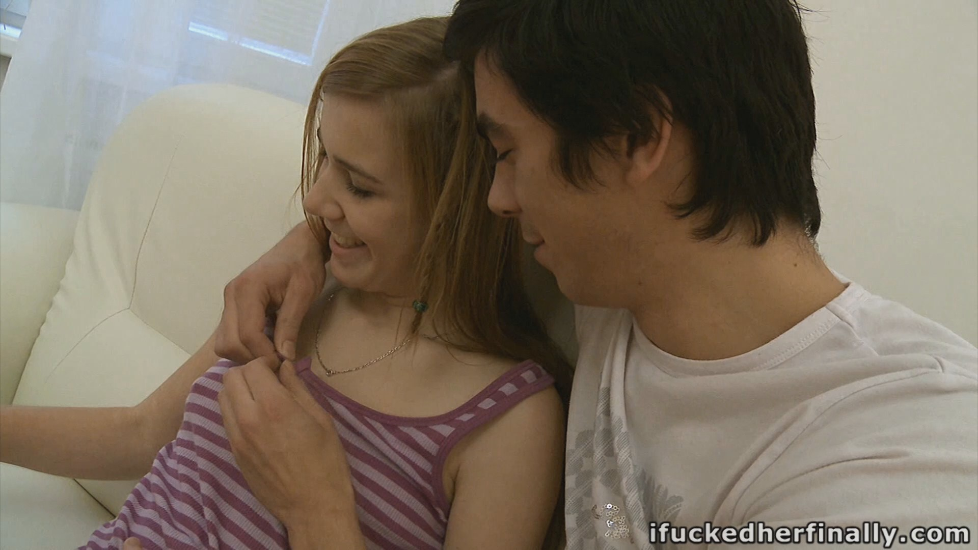 Very young-looking teenage cutie having fun with her boyfriend